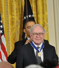 Warren Buffett, shown here receiving a Medal of Freedom from President Obama, is steering Berkshire Hathaway to acquire chemical company Lubrizol