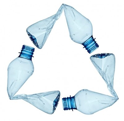 three plastic bottles in shape of recycling logo