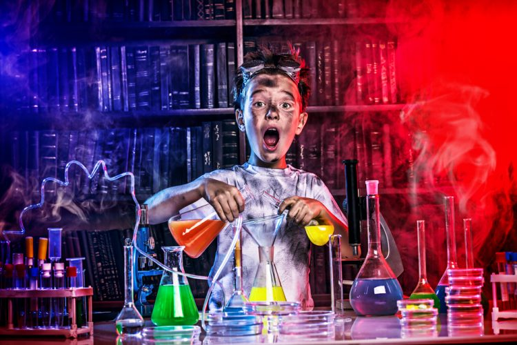 Young boy experimenting with chemicals